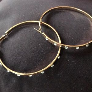 Gold hoops with jewels in front
